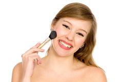 Young Woman Applying Make-up Royalty Free Stock Photography