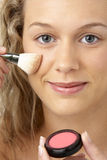 Young Woman Applying Make-Up Royalty Free Stock Photo