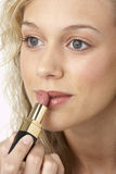Young Woman Applying Make-Up Royalty Free Stock Photos