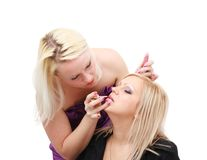Young woman applying makeup Stock Image