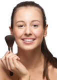 Young woman applying makeup Royalty Free Stock Photo