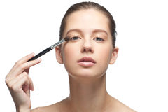 Young woman applying makeup Royalty Free Stock Photography