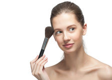 Young woman applying makeup Stock Images
