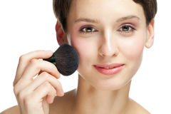 Young woman applying makeup Stock Photography