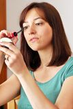 Young woman applying makeup Royalty Free Stock Images