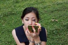 Young woman applying mascara Stock Photos