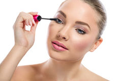 Young woman  applying mascara Royalty Free Stock Images