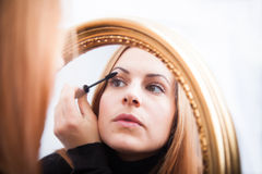 Young woman applying mascara Royalty Free Stock Image