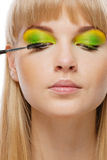 Young woman applying mascara ush Royalty Free Stock Image