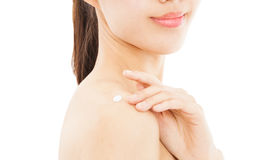 Young woman applying moisturize cream Stock Image
