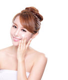 Young woman applying moisturizer cream on face. Portrait of young woman applying moisturizer cream on her pretty face isolated on white background, asian beauty Royalty Free Stock Image