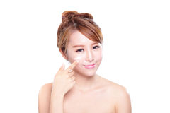 Young woman applying moisturizer cream on face. Portrait of young woman applying moisturizer cream on her pretty face isolated on white background, asian beauty Royalty Free Stock Photos