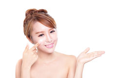 Young woman applying moisturizer cream on face. Portrait of young woman applying moisturizer cream on her pretty face isolated on white background, asian beauty Stock Image