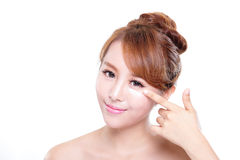 Young woman applying moisturizer cream on face. Portrait of young woman applying moisturizer cream on her pretty face isolated on white background, asian beauty Stock Photos