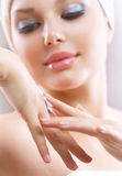 Young Woman Applying Moisturizing Cream Stock Photography