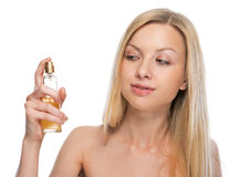 Young woman applying perfume Stock Images