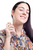 Young woman applying perfume on herself Royalty Free Stock Photos