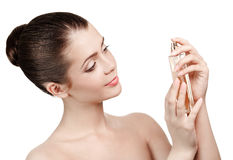 Young woman applying perfume on herself Royalty Free Stock Images