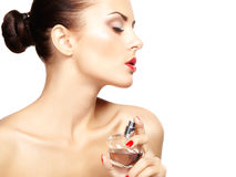 Young woman applying perfume on herself isolated on white backgr Royalty Free Stock Photography
