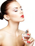 Young woman applying perfume on herself isolated on white backgr Stock Photography