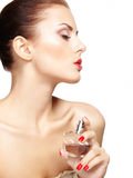 Young woman applying perfume on herself isolated on white backgr Stock Images