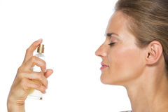 Young woman applying perfume Royalty Free Stock Photography