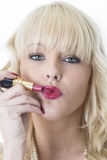 Young Woman Applying Red Lipstick Royalty Free Stock Photos