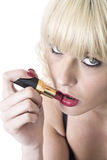 Young Woman Applying Red Lipstick Royalty Free Stock Image