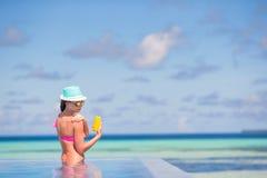 Young woman applying sun cream during beach Stock Photos