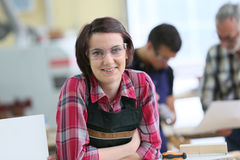 Young woman apprentice in carpentry Stock Photography