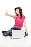 Young woman approving laptop Royalty Free Stock Image