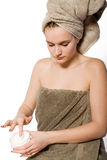 Young woman appying some creme Royalty Free Stock Photo