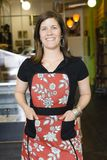 Young Woman in Apron royalty free stock photography