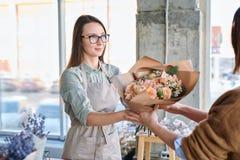 Florist serving client stock photography