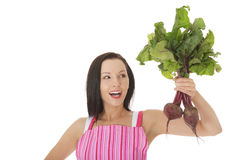 Young woman in apron and holding beetroots. Stock Photo
