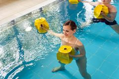 Young woman in aquarobics class stock photography