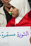 Young woman in the Arab revolution. In Tahrir Square Royalty Free Stock Photo
