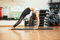 Young woman arching her back at a gym Royalty Free Stock Photos