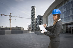 Young woman architect in the construction site Stock Photos