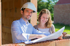 Young woman and architect on construction site Stock Image