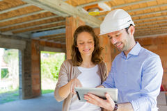 Young woman and architect on construction site Royalty Free Stock Images