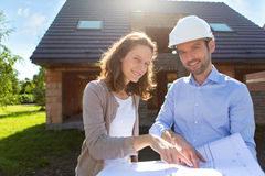 Young woman and architect on construction site Royalty Free Stock Photo