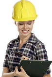 Young woman architect with helmet Royalty Free Stock Photos