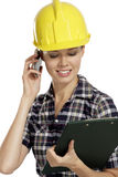Young woman architect with helmet Royalty Free Stock Photography