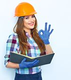 Young woman architect holding business paper show OK. Smiling girl portrait against white wall. Woman worker builder stock images