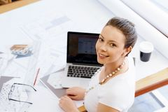 Young woman architect in office Royalty Free Stock Images