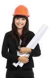 Young woman architect with orange helmet. Young woman architect with orange hardhat helmet and project in isolated background Stock Photography