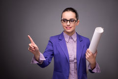The young woman architect pressing buttons Royalty Free Stock Photography
