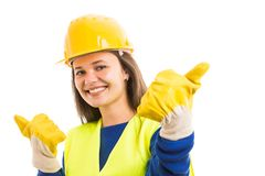 Young woman architect showing thumbs up. Young woman architect or engineer showing thumbs and smiling up as successful construction project concept isolated on stock image