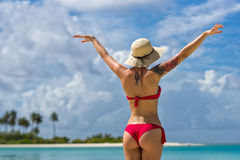 Young woman with arms apart on sand beach.  stock image